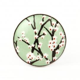 Flacher Möbelknauf mit aufgedrucktem Kirschblütenmuster in grün