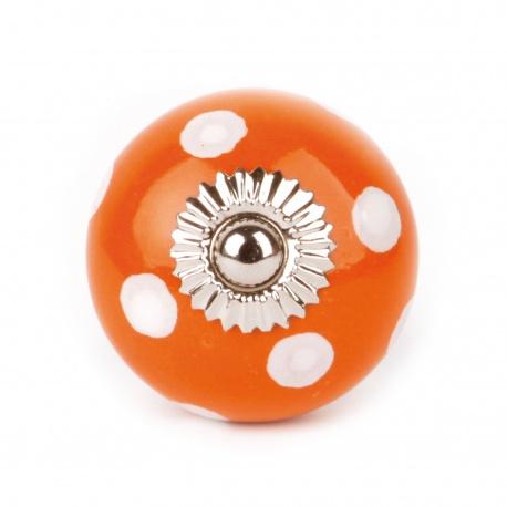 Möbelknauf in orange mit weißen Punkten