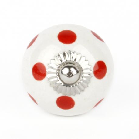 Großer weißer Möbelknauf mit roten Punkten