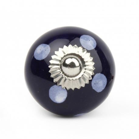 Kleiner dunkelblauer Möbelknauf mit weißen Punkten