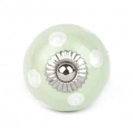 Mintgrüner Möbelknauf mit weißen Punkten in klein