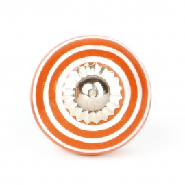 Kleiner oranger Möbelknauf mit weißen Streifen