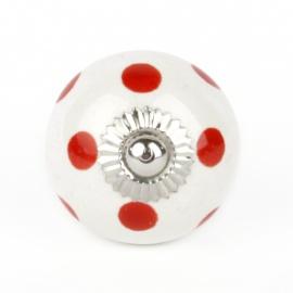 Kleiner Möbelknauf in weiß mit roten Punkten
