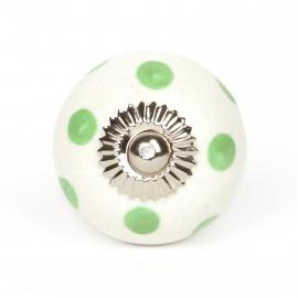 Weißer runder Möbelknauf mit grünen Punkten