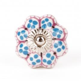 Möbelknauf in Blütenform mit lila Muster und blauen Punkten