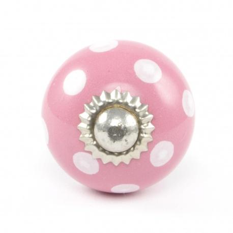 Kleiner rosa Möbelknauf mit weißen Punkten