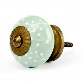Mintfarbener Keramikknauf mit weißem erhabenem Blattmuster und messingfarbigem Gewinde