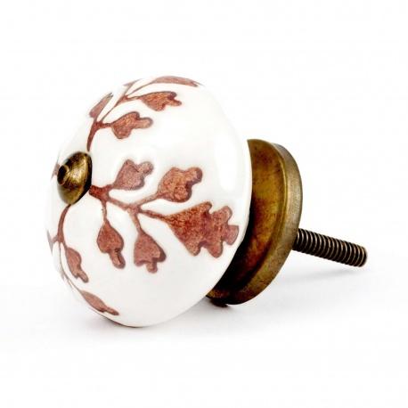 Beigefarbiger Möbelknopf mit kupferbraunem Eichenblattmuster