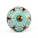 Großer Möbelknopf in türkis mit braunem Ornamentmuster und messingfarbigem Gewinde